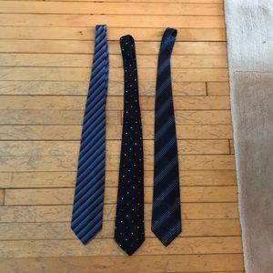Three men's blue silk ties.  Banana Republic.
